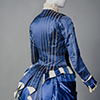 view of bustle of a silk blue day dress from 1880s