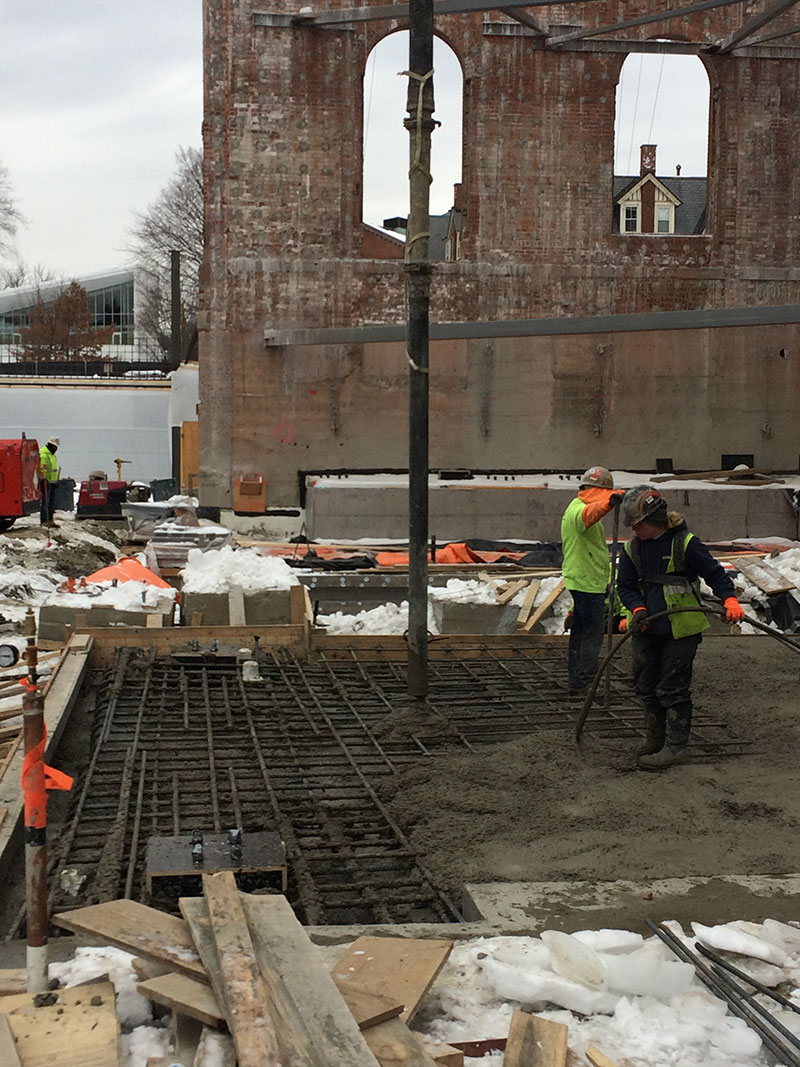 Placing a section of concrete mat slab in the core of 1909.