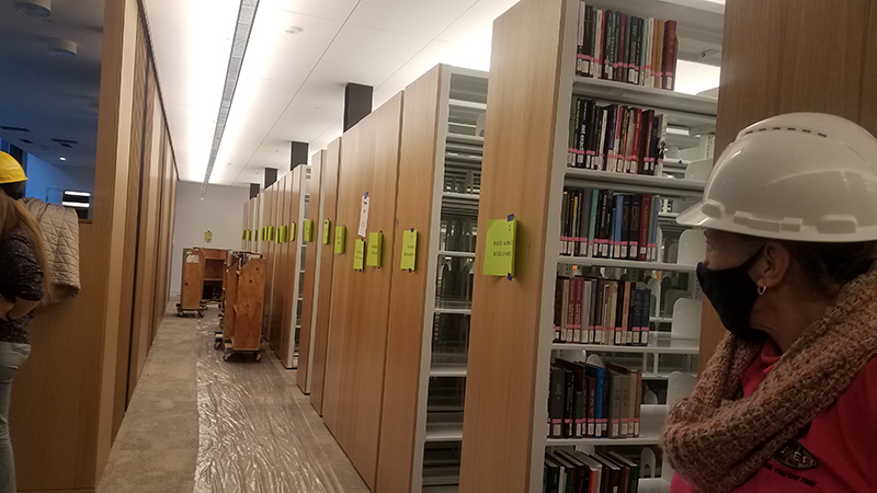 mover looking down a row of bookshelves in the Neilson library
