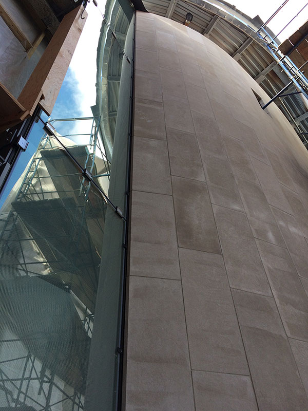 Intersection of the glass throat wall and the north addition limestone