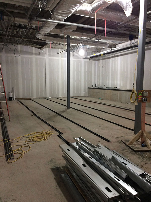 collections storage areas, the rails to support the compact storage units are being placed