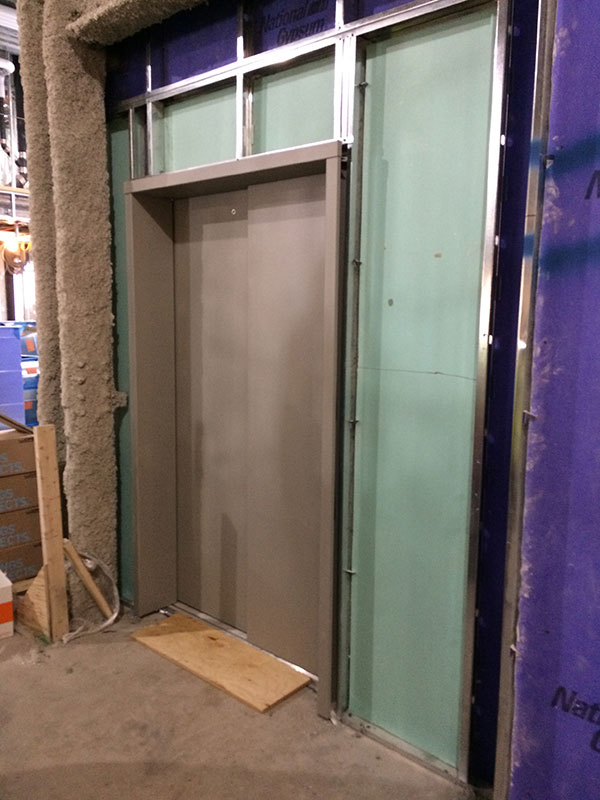 elevator behind this door and another 4 elevators being installed in the two buildings