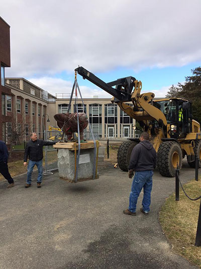 Sculpture being moved outside Wright Hall