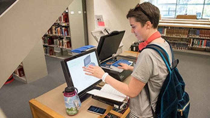 Student using printer, scanner in Hillyer Art Library