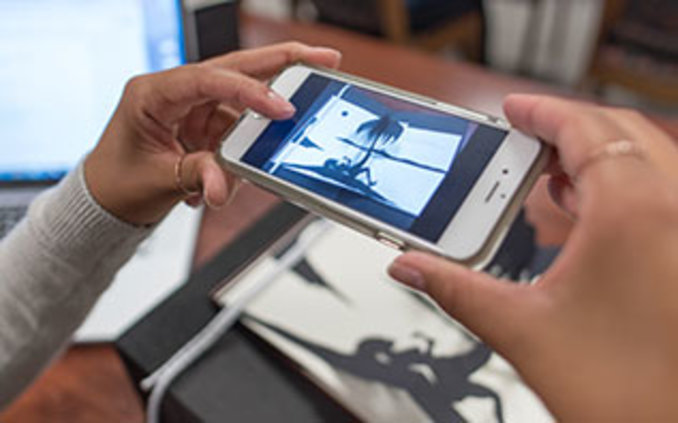 Researcher using mobile device in Special Collections