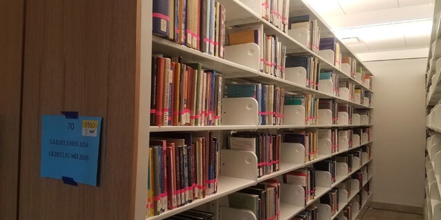 books on metal shelves in the Neilson Library