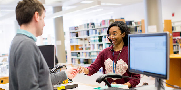 Librarian working with student in Young Library