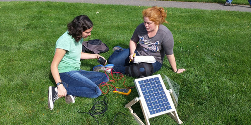 Students working on solar power experiment