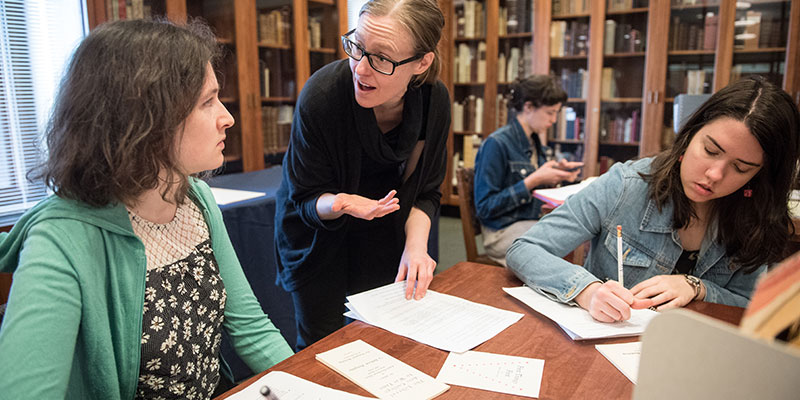 Curator of Rare Books working with student