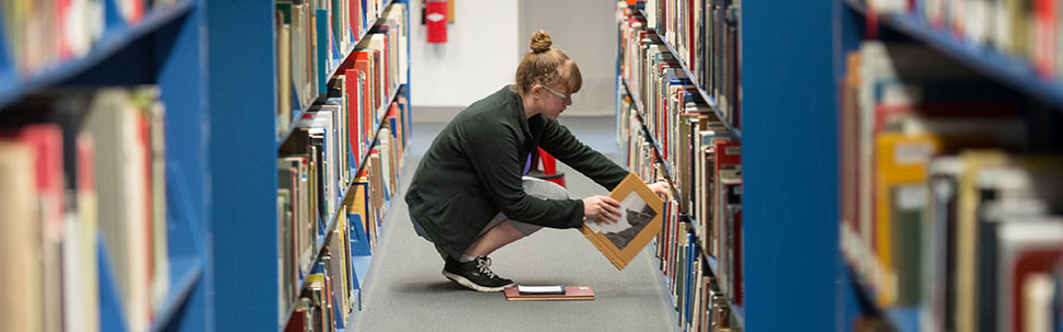 Student in the stacks