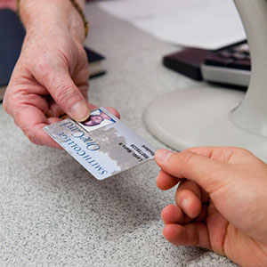 Close up of hands exchanging OneCard