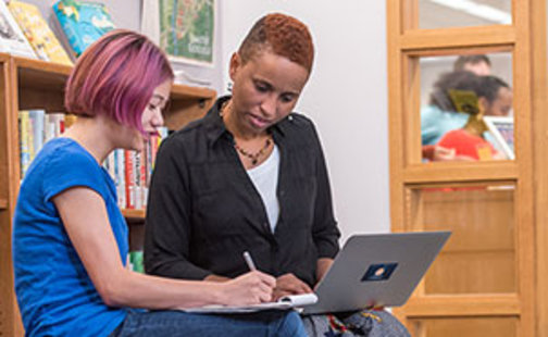 librarian working with student